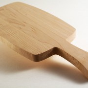 Small wooden bread board with handel profile